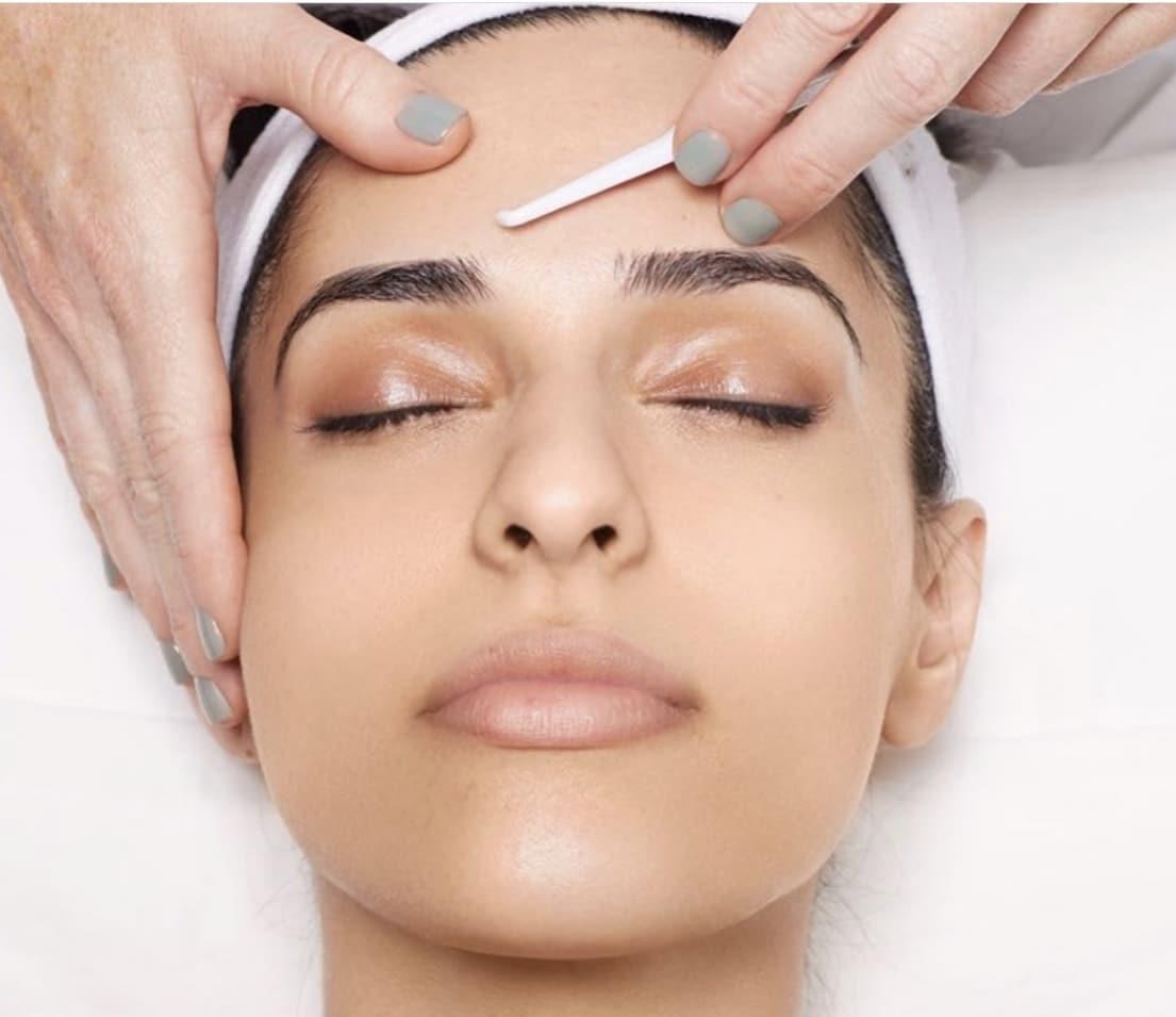 Woman having Facial Dermaplaning