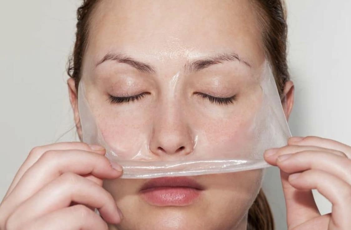 Image of woman pulling ZO 3 Step peel off her face